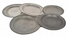 A COLLECTION OF FIVE PEWTER PLATES various sizes, the largest 38.5cm diameter