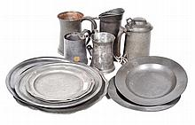 A COLLECTION OF PEWTER DRINKING VESSELS AND PLATES including two mugs, three tankards, and seven plates of various size and design, the largest plate 32cm diameter, (12)
