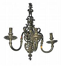 A PAIR OF 19TH CENTURY FRENCH GILT BRASS WALL SCONCES each with a pierced back plate and three scroll arms terminating in sconces, 76cm high
