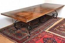 A FRENCH PROVINCIAL STYLE REFECTORY TABLE with a rectangular three sectional top above a wrought iron scroll base with four stretchers, 301 x 74 x 120cm