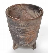AN ANCIENT NEAR-EASTERN EARTHENWARE TRIPOD VESSEL, CIRCA LATE SECOND MILLENIUM - EARLY FIRST MILLENIUM B.C.