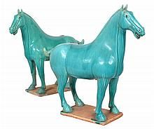 A PAIR OF HAN STYLE GREEN GLAZED EARTHENWARE HORSES 40cm high