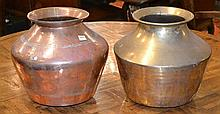 ONE COPPER AND ONE BRASS JARDINEREof baluster form with a flared rim, 30cm high