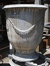 A PAIR OF CREAM GROUND ANDUZE COMPOSITE URNS  each cast with armourial crests and foliate swags, 80cm high  as featured in Paul Bangay 'Garden Design Handbook' throughout