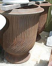 A PAIR OF COMPOSITE URNS WITH BRONZE PATINATION  each with a wrythen body, 102cm high  as featured in Paul Bangay 'Garden Design Handbook' pp. 52-53, 302-303