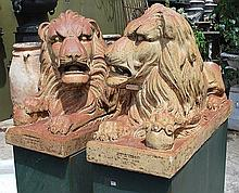A FINE PAIR OF 19TH CENTURY ENGLISH GLAZED TERRACOTTA LIONS manufacturer's stamp for Speirs, Gibb & Co., Caledonia works, Paisely, in seated positions, some remnant glaze, each with a factory stamp to the front of the plinth base, supported on green