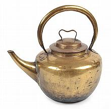 A CHINESE BRASS TEAPOT  with a loop handle, 30cm high