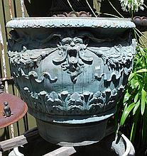 A PAIR OF LIMED PATINATED FINISH LEMON POTS  of baluster form, richly ornamented with mask heads, garlands and acanthus leaves, 74cm high  as featured in Paul Bangay 'Garden Design Handbook' p. 78