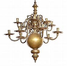 AN 18TH CENTURY DUTCH BRASS CHANDELIER  with a lobed body and two tiers with six scroll arms, 95cm high