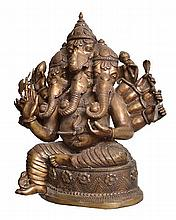 A BRONZE FIGURE OF GANESH  the deity in the heramba ganapati form, with five heads and many arms, accompanied by attendants, 65cm high