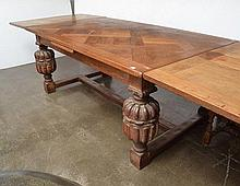 A CHARLES I STYLE OAK REFECTORY TABLE  rectangular, with a parquetry inlaid top and a cross banded border above baluster supports united by a cross stretcher, 300 x 78 x 110 cm