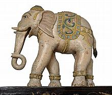 AN INDIAN PAINTED WOODEN ELEPHANT  77cm high