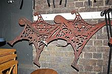 A PAIR OF VICTORIAN CAST IRON ENDS