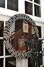 A PAIR OF CIRCULAR  INLAID BLACK AND WHITE ZEBRA PATTERNED MIRRORS