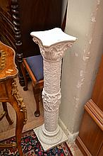 A PAIR OF CLASSICAL STYLE COMPOSITE STONE PEDESTALS