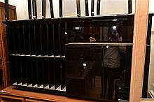 A CONTEMPORARY BLACK LACQUERED SIDEBOARD WITH RECORD STORAGE