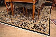 A QUALITY HANDMADE 'HALI' RUG IN BLACK, CREAM AND OLIVE TONES (3.06M X 2.43M), CERTIFICATE OF AUTHENTICITY IN OFFICE