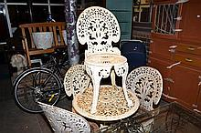 A THREE PIECE CAST IRON OUTDOOR SETTING AND TWO SIMILAR VICTORIAN CAST IRON CHAIRS