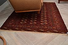 A TURKOMAN TEKKA RUG IN RICH RED AND NAVY PATTERNS