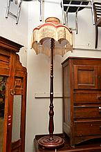 AN ANTIQUE STYLE STANDARD LAMP