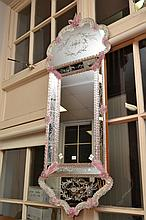 A 1950'S VENETIAN MIRROR WITH PINK AND CLEAR CANDY TWIST AND FLORAL MOTIFS