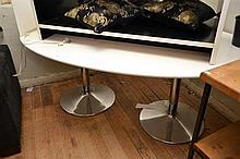 A WHITE CONTEMPORARY OVAL SHAPE DINING TABLE