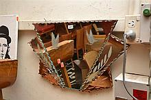 A SMALL ART DECO MIRROR WITH BUTTERFLY MOTIFS