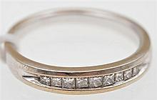A PRINCESS CUT DIAMOND CHANNEL SET RING, IN 18CT WHITE GOLD