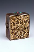 A TANTRIC GAHU AMULET BOX, copper with a gilded front, repousse skeleton dancer, phoenixes, snow lions, skulls, and Buddhas, incised...