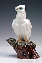 THREE PORCELAIN FIGURES, including eagle, Hirado porcelain sake pourer and figure of Daikoku The eagle, 27.5cm high
