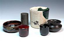 A PORTABLE TEA CEREMONY SET IN BOX, containing a small hibachi, tea caddy, mixing bowl and water vessel The box 48 x 17.5 x 17.5cm