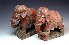 A PAIR OF 19TH CENTURY  POLYCHROME ELEPHANTS