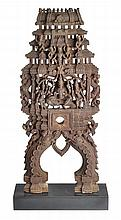 A FINELY CARVED 19TH CENTURY KATHAKALI DANCERS HEADPIECE, KANATAKA, SOUTH INDIA, modelled with deities and attributes 59cm high