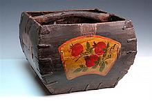 A COLLECTION OF FIVE WOODEN OBJECTS AND A PLAITED BASKET, including childs bath, two rice measures, a red lacquered water scoop, and...