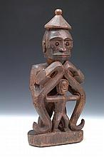 A WEST PAPUA, KORWAR FIGURE, modelled as father and son, open work carving, 30cm high