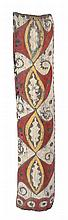 A WASHKUK REGION CARVED TOTEM BOARD, PNG,  reverse hollow, stylised sago beetles, with scroll motif at sides, 118 x 23cm