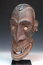 A SUBSTITUTE ANCESTOR SKELETON HEAD, SEPIK REGION,  23cm high