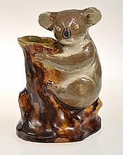 KOALA ON BRANCH FORMED VASE UNSIGNED, .POSSIBLY