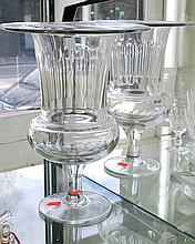 A PAIR OF GEORGIAN STYLE FACETED GLASS URNS; PURCHASED FROM KOZMINSKY