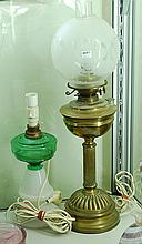 TWO ELECTRIFIED KEROSENE LAMPS, ONE COLUMNAR AND DECO