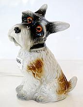 A KITSCH BEDSIDE TABLE LAMP IN THE SHAPE OF A TERRIER