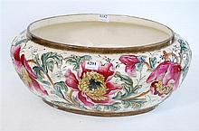 AN EARLY 20TH CENTURY FRENCH BASIN WITH EXTENSIVE FLORAL DESIGN (SOME FAULTS)