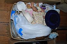A BOX OF ASSORTED DOLLS AND TEAWARE