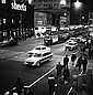 ANGUS O'CALLAGHAN (BORN 1922) Crossing Swanston Street at Night archival print on rag paper 1/15