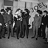 THE BEATLES AT CONFERENCE/RECEPTION (PUTTING ANIMAL SKIN AROUND HOST)