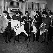 THE BEATLES HOLDING UP ANIMAL SKINS AT CONFERENCE/RECEPTION II