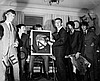 THE BEATLES HOLDING UP PORTRAIT OF JOHN LENNON AT CONFERENCE/RECEPTION