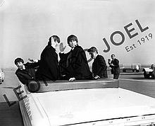 THE BEATLES WAVING FROM CAR AT ADELAIDE AIRPORT
