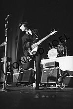 GEORGE HARRISON PERFORMING ON STAGE II