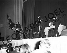 THE BEATLES PERFORMING ON STAGE II